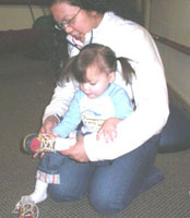 Mother Helping child learn to tie